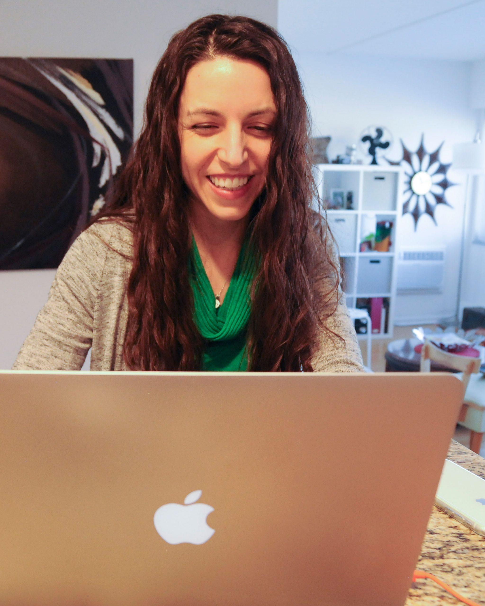 Lori smiling while working